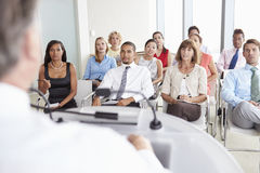 Business Delegates Listening To Presentation At Conference Royalty Free Stock Photos