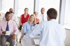 Business Delegates Listening To Presentation At Conference Royalty Free Stock Photography
