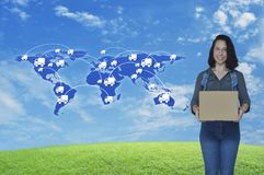 Business delivery and transportation concept, Elements of this i. Smiling young woman holding parcel box with delivery truck icon, connection lines and world map Royalty Free Stock Images