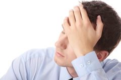 Business depression. Businessman in depression with hand on forehead, isolated over white Royalty Free Stock Photo