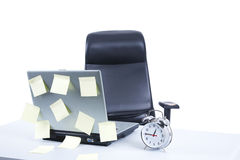Business desk. With laptop, alarm clock and post it stock photos