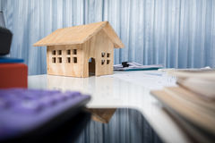 Business desk close up with house wood model. Stock Photos