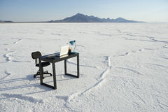 Business Desk and Empty Office Chair Outdoors White Desert Royalty Free Stock Photography