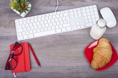 Business desk with a keyboard and  breakfast Stock Photo