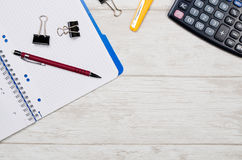 Business desk in office top view banner concept. Business desk in office top view. Table with calculator, notepad, and office supplies. Copy space website banner royalty free stock photos