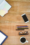 Business desk with smartphone and colors pencil Stock Photography