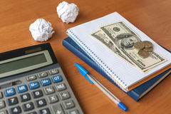 Business desktop with calculator, notebook, money Stock Images