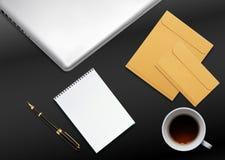 Business desktop with laptop. Notepad, envelops and mug of tea Stock Images