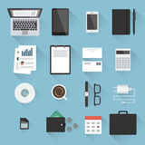 Business desktop objects. Set in flat style with light shadows: laptop, tablet, smartphone, notebook, envelopes, calculator, paperwork, CD, calendar, adapter Stock Photography