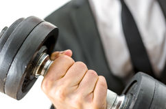 Business determination. Closeup of businessman lifting heavy weights. Concept of determination in business stock photos