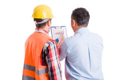 Business developer and contractor builder discussing charts Royalty Free Stock Images