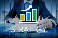 Businessman with strategy text and increasing graph overlay royalty free stock image