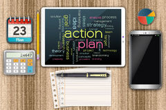 Business development planning. Computer tablet with an action plan. Tablet on the wooden table Royalty Free Stock Photos