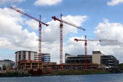 Business development on riverside. New office constructions in progress beside river in Bristol Royalty Free Stock Image
