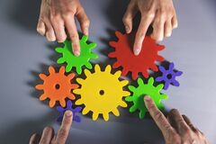 Free Business Development, Teamwork And Partnership Concept - People Connecting Gears Royalty Free Stock Image - 199034406