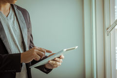 Business Device. Business concept, A businessman pressing a tablet Royalty Free Stock Photos