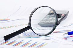 Business diagramme with magnifying glass Stock Images