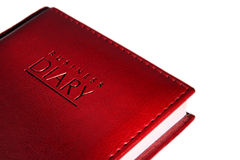 Business diary. Business  calendar of red colour a close up on a white background Royalty Free Stock Photo