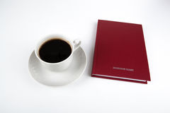 Business diary with cup of coffee Royalty Free Stock Photography