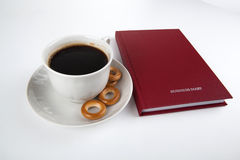 Business diary with cup of coffee 2 Stock Photos