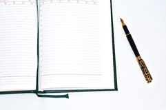 Business diary with gold pen Stock Photo