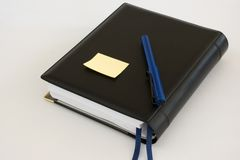 Business diary organiser with blue pen and note Royalty Free Stock Photo