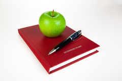 Business diary with pen and green apple Stock Photos