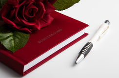 Business diary with rose and pen Royalty Free Stock Photos
