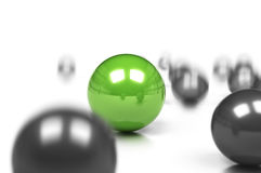 Business difference. Competitive edge and business difference concept, many grey balls and one green sphere onto a white background with movement effect and blur Royalty Free Stock Image