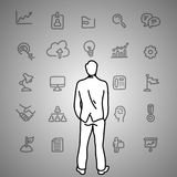 Business dilemma. Businessman looking at the gray business icons. On the wall vector illustration doodle sketch hand drawn with black lines  on gray background Stock Photography