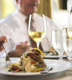 Business dinner. Of flounder, vegetables, and wine Royalty Free Stock Photo