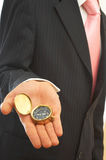 Business direction. Businessman holding an old compass on white Royalty Free Stock Images