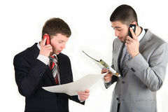 Business discussion and exchange of information. Two businessman talking on the phone   telephone and discuss the information Royalty Free Stock Photo