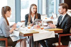 Business discussion at the lunch between Royalty Free Stock Photos