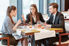 Business discussion at the lunch between Stock Photography