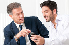 Business discussion with mobile phone Royalty Free Stock Photography