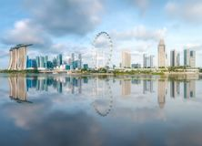 Business district and Marina bay in Singapore. View of business district and Marina bay skyline with reflection on water, during sunrise in Singapore stock image