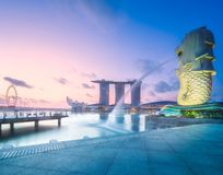 Business district and Marina bay in Singapore. View of business district and Marina bay skyline at sunrise in Singapore stock image