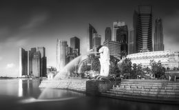 Business district and Marina bay in Singapore. View of business district and Marina bay skyline at sunrise in Singapore . Black and white concept Stock Image