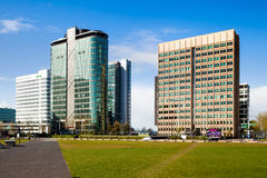 Business district with office buildings in Amsterdam city, Netherlands Stock Image