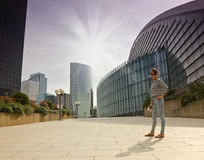 Business district of Paris La Défense. Girl hiker looking at maps in the business district of Paris La Défense. Tours in Europe Royalty Free Stock Photo