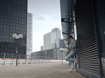 Business district of Paris La Défense. Girl hiker looking at maps in the business district of Paris La Défense. Tours in Europe Royalty Free Stock Images