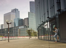 Business district of Paris La Défense. Girl hiker looking at maps in the business district of Paris La Défense. Tours in Europe Royalty Free Stock Image