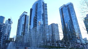 Business district Vancouver Canada. Fountain downtown Vancouver evening buildings stock footage