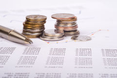 Business document with coins Stock Photography