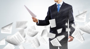 Business documentation. Close up of businessman with papers in hands Stock Photos