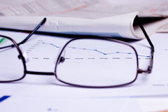 Business documents. Different business documents, viewed trough some glasses Royalty Free Stock Image