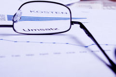 Business documents. Different business documents, viewed trough some glasses Stock Photos