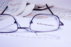 Business documents. Different business documents, viewed trough some glasses Stock Photo