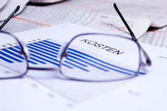 Business documents. Different business documents, viewed trough some glasses Royalty Free Stock Photo